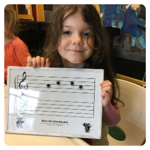 girl learning music at doremi academy