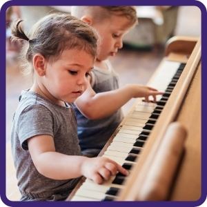 small kids leaning piano at doremi academy